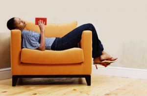 Woman in yellow chair with book
